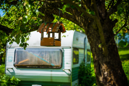countrylife: Birdhouse and a camper Stock Photo