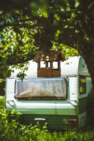 birdhouse: Birdhouse and a camper Stock Photo