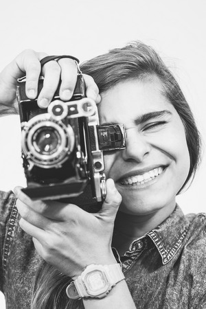 moskva: Teenager girl with an old folding camera portrait.