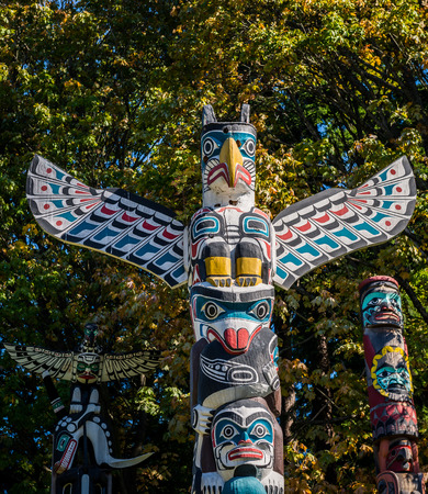 northwest indian art: Photo of the colourful totems on a sunny day.