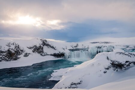 Photo of the Godafoss waterfall in winter Iceland