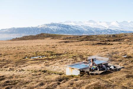 Icelandic hotpot among the amazing lagoon and mountains