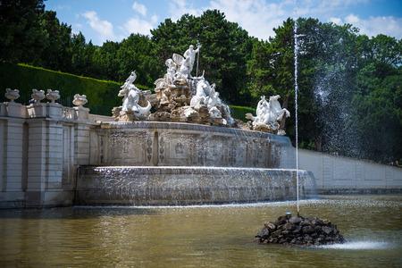 Public fountain at Schuenbrunn Palace - former imperial summer residence, Vienna, Austria