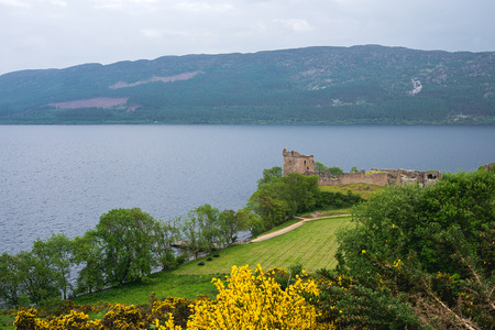 Urquhart Castle on Loch Ness lake, Scotland