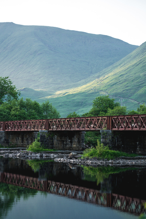 Old metal bridge among scottish scenery, Scotland, UK.