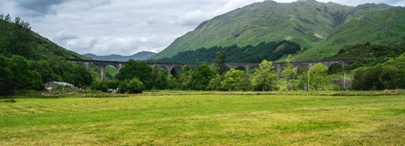 Glenfinnan Viaduct, tourist attraction featured in popular film about young wizard, Scotland, UK 版權商用圖片