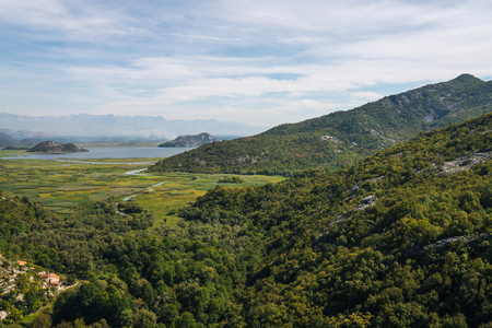Lake Skadar — also called Lake Scutari, Lake Shkodër and Lake Shkodra — lies on the border of Albania and Montenegro, and is the largest lake in Southern Europe. It is named after the city of Shkodër in northern Albania. It is a karst lake. Stock Photo