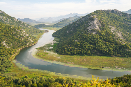Horseshoe Bend type like landscape in Lake Skadar National Park — also called Lake Scutari, Lake Shkodër and Lake Shkodra — lies on the border of Albania and Montenegro, and is the largest lake in Southern Europe. It is named after the city of Shkodër in northern Albania. It is a karst lake.