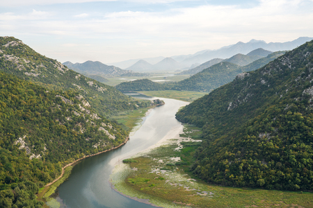 'Horseshoe Bend' type like landscape in Lake Skadar National Park — also called Lake Scutari, Lake Shkodër and Lake Shkodra — lies on the border of Albania and Montenegro, and is the largest lake in Southern Europe. It is named after the city of Shkodër in northern Albania. It is a karst lake.