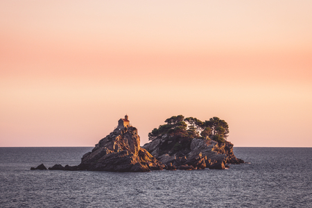 It is located opposite the town of Petrovac. It has a small church of the same name built upon it. Coupled with the other islet, Katič, it makes an attraction for diving enthusiasts. 版權商用圖片