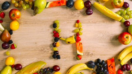 generates: Fruits made letter H. Alphabet on a table. Summer harvest generates letters.