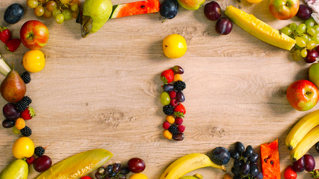 Fruits made letter I. Alphabet on a table. Summer harvest generates letters.