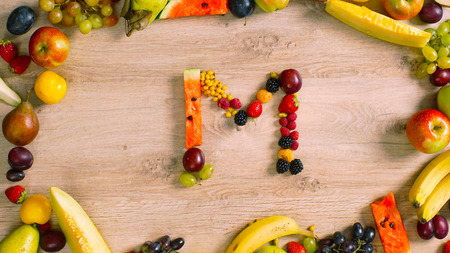 generates: Fruits made letter M. Alphabet made of fruits. Summer harvest generates letters Stock Photo