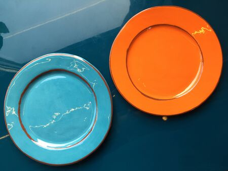 rimless: Two empty ceramic plates stand on the table.