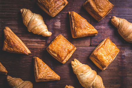 Croissants and puff pastries lie on the table.