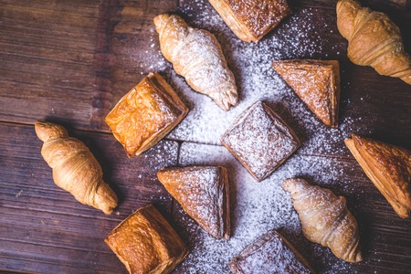 Buns from puff pastry sprinkled with powdered sugar.