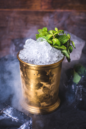 Crushed ice in a tin can on the table.
