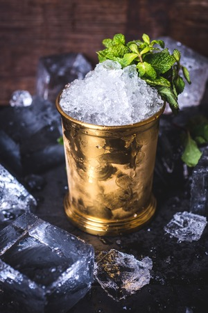 The ice in the tin can is decorated with mint. Archivio Fotografico