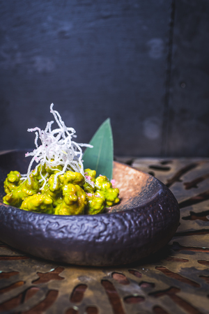 The food of molecular cuisine on an iron plate.