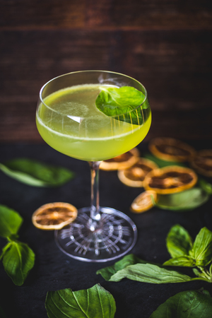 Top view of a floating mint leaf in a cocktail.