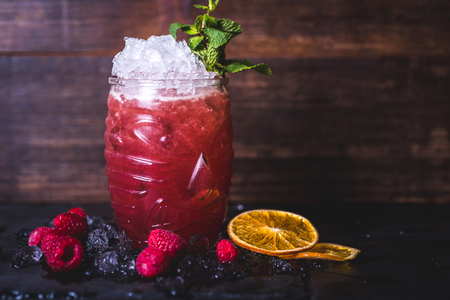 Pink cocktail with lemon in a glass. Фото со стока