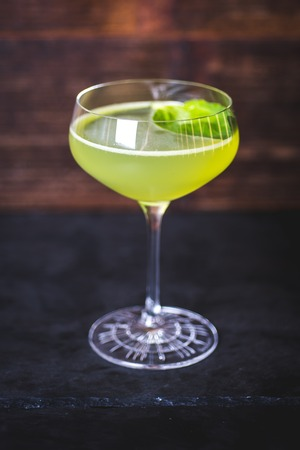 A view of the cocktail in a wine-glass on the table.