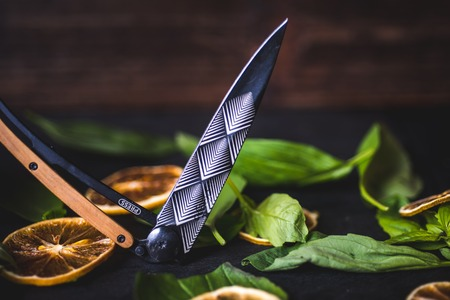 An open folding knife lies on the table.
