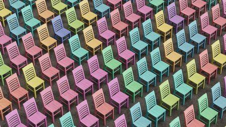 cor: A large an well ordered isomteric array of colorfully stained wooden chairs facing a single direction. This image is a 3D illustration. Stock Photo