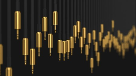 mini jack: Huge line of gold plated 3.5mm audio connections of varying lengths against a simple black background. The shot features a shallow depth of field. This image is a 3d rendering. Stock Photo