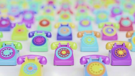 Array of variously multicolored retro rotary phones of a clean white surface. This image a 3d render and features a shallow depth of field. Stock Photo
