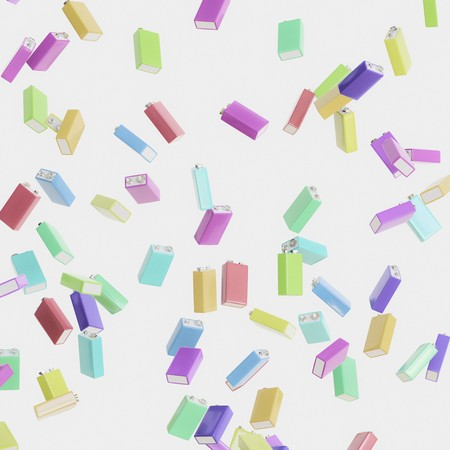 Vibrantly colored nine volt batteries floating in empty white space. This image is a 3d render. Stock Photo