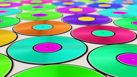 Neat uniform array of variously coloured vinyl records under clean studio lighting. This image is a 3d illustration.