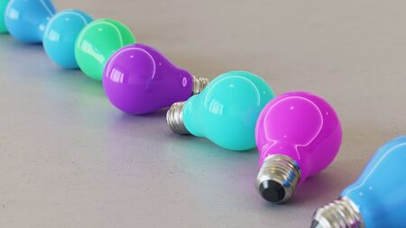 Neat line of variously oriented lightbulbs on a modern minimalistic neutral surface. This image is a 3d rendering.