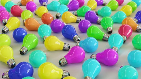 Neat uniform array of variously coloured lightbulbs under clean studio lighting. This image is a 3d illustration.
