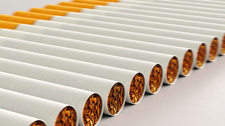 Close up on a tightly packed, perfectly aligned linear array of variously colored cigarettes on a simple modernist neutral surface. This image is a 3d render.