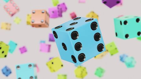 Floating white dice against a white background and array of out of focus Dice of various colors. This image is a 3d render. Stock Photo