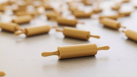 Large scattered array of wooden rolling pins arranged on a minimally textured white concrete surface. This image is a 3d rendering. Stock Photo