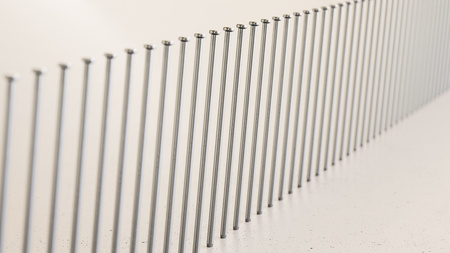 Close up on a tightly packed, perfectly aligned linear array of variously colored nails on a simple modernist neutral surface. This image is a 3d render.