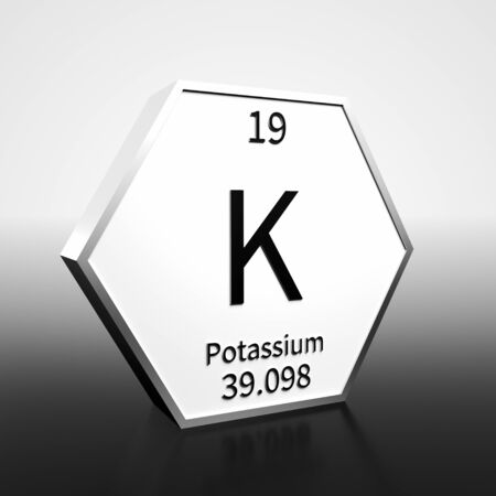 Metal hexagonal block representing the periodic table element Potassium. Presented as black text on a white backing plate with a black and white gradient background. This image is a 3d render.
