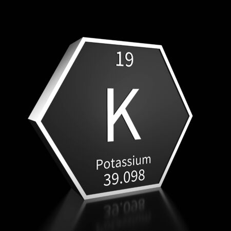 Metal hexagonal block representing the periodic table element Potassium. Presented as white text on a black backing plate with a black background. This image is a 3d render.