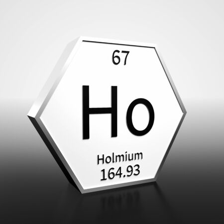 Metal hexagonal block representing the periodic table element Holmium. Presented as black text on a white backing plate with a black and white gradient background. This image is a 3d render.