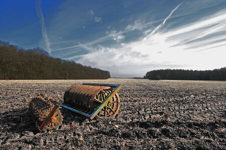 Landscape with old rusty agricultural equipment  photo