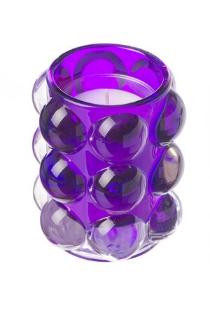 tealight: isolated purple tealight candle Stock Photo