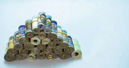 Rolls and Bundles of Naira Cash local currencies in a pyramid heap