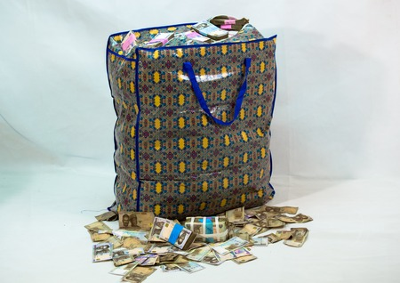 Bag of Naira note Cash and local currencies Stock Photo - 124280786