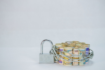 Bundles of naira cash chained and padlock concept of Esecurity on white background