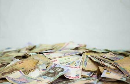 Heap of nigeria naira notes on white background