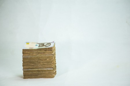 Stack of nigeria naira notes on white background