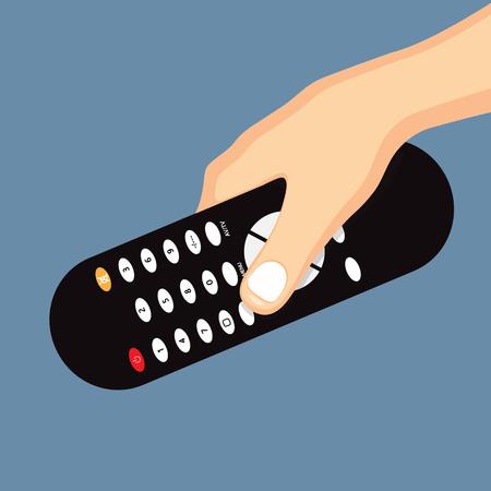 remote: Hand holding remote control.