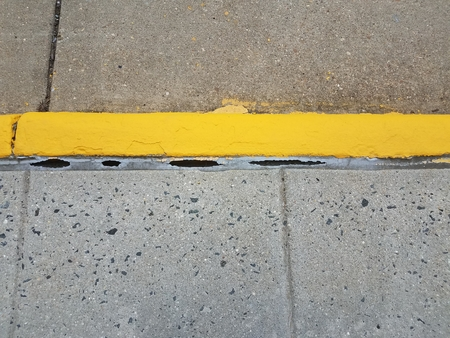 yellow paint and cement curb and sidewalk Stock Photo - 80014297
